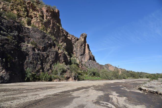 Arizona has adopted legislation on water quality in streams and rivers. In this image, the Hassayampa River bed runs alongside Volcanic cliffs.