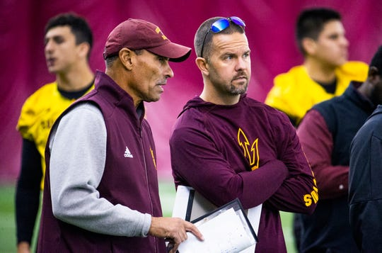 Arizona State University head football coach Herm Edwards speaks with newly hired offensive coordinator Zak Hill during practice at the Verde Dickey Dome on campus in Tempe, Tuesday, December 17, 2019.