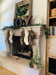 The fireplace is the perfect example of Jessica's comfortable yet stylish design sense.
