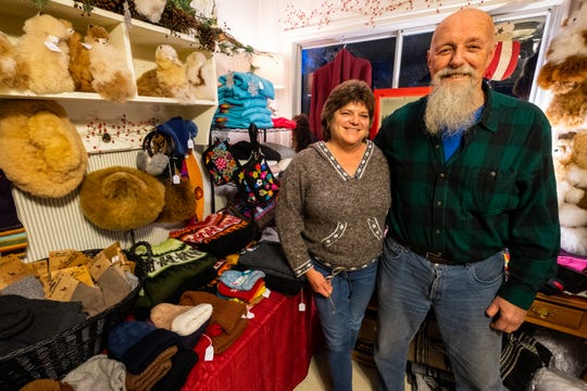 George Dzierzbicki and his wife, Sherry Miramonti, photographed Friday, Dec. 13, 2019, operate Smiths Creek Alpacas Christmas Shop. The married couple also raise alpacas on the 5-acre farm, which also has two Nigerian pygmy goats, a dog and a cat.