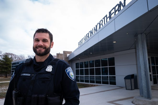 Port Huron Police School Resource Officer Dennis Huisman stands for a portrait Tuesday, Dec. 17, 2019, outside of Port Huron Northern High School. Port Huron recently renewed its school resource officer program for three more years.