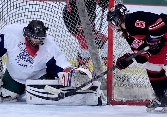 Dallastown goalie Alexander Sears blocks a shot attempt by Julianna Baibos of Susquehannock, Monday, December 16, 2019.  John A. Pavoncello photo