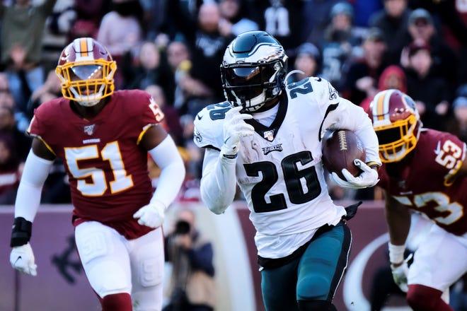 Philadelphia Eagles running back Miles Sanders (26) runs the ball during an NFL football game against the Washington Redskins, Sunday, Dec. 15, 2019, in Landover, Md. (AP Photo/Mark Tenally)