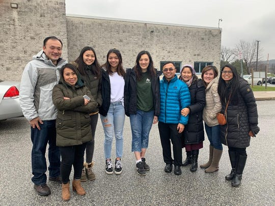 Ellyana Sukwanputra, center, was released from York County Prison after being held for six months pending deportation. She won a bail hearing Monday and was reunited with her family. Her daughters are to her left.