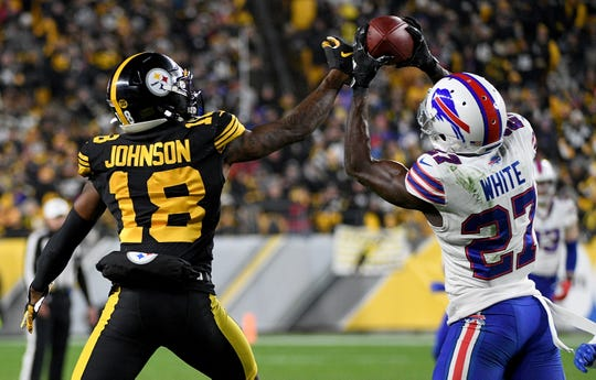 Tre'Davious White of the Buffalo Bills intercepts a pass intended for Diontae Johnson of the Pittsburgh Steelers in the third quarter during Sunday's game in Pittsburgh. White was selected to the Pro Bowl on Tuesday.