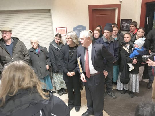 Supporters surround Elizabeth Catlin and her attorney David Moribito after her appearance in Penn Yan Village Court Jan. 7, 2019.
