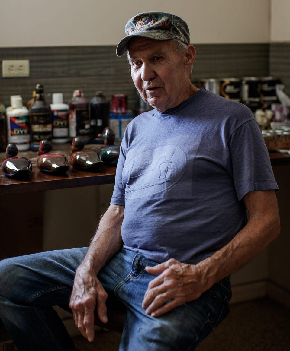 John Bundy sits inside his workshop in Strawtown where he makes duck decoys. Bundy was one of the first to notice something was wrong in the White River after the 1999 Guide spill that killed more than 4 million fish. He started an organization, White River Rescue, that raised money to restock fish in the river.