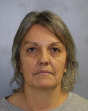 Elizabeth Catlin is accused of not being a certified midwife in New York.