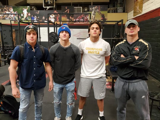 West Valley wrestlers: freshman Niall Raby (left), senior Connor Edwards (left-centered), senior Rocky Raby (right-centered) and senior Cade Lambert (right) at their school's weight room on Dec. 17, 2019.