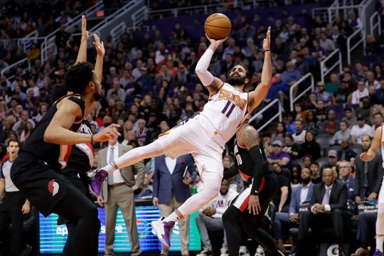 Phoenix Suns guard Ricky Rubio (11) shoots against the Portland Trail Blazers during the second half of an NBA basketball game, Monday, Dec. 16, 2019, in Phoenix. The Trail Blazers won 111-110.