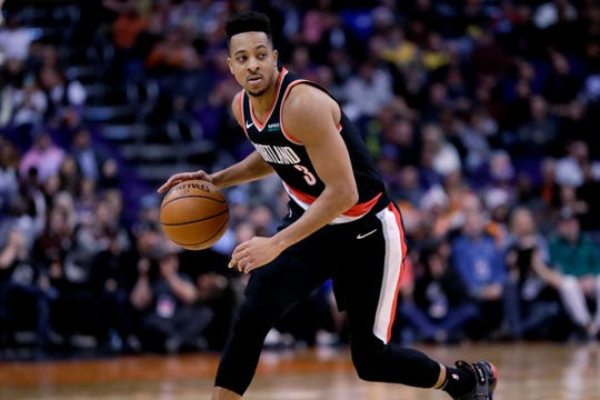 Portland Trail Blazers guard CJ McCollum (3) looks to pass against the Phoenix Suns during the first half of an NBA basketball game, Monday, Dec. 16, 2019, in Phoenix.