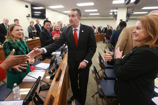 Virginia Gov. Ralph Northam, center, greets legislators after he delivered his budget briefing before a meeting of the House Appropriations Committee and the Senate Finance Committee at the Capitol in Richmond.