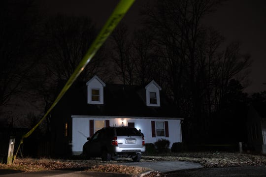 Law enforcement marks evidence while investigating shots fired on Springfield Circle on Monday, Dec. 16, 2019.