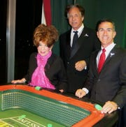 """Sandi and Jeffrey Kallenberg and Danny Aiello, there with  wife Shonnee, at the craps table during """"Las Vegas Night."""""""