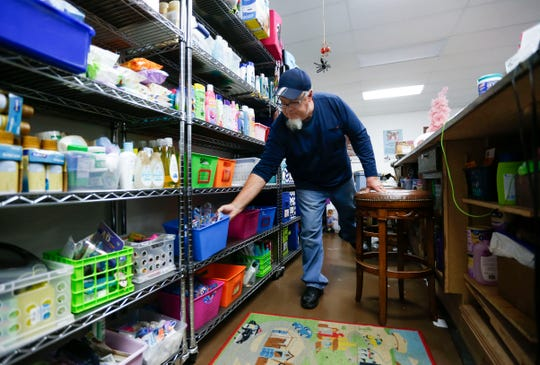 Mark Hay grabs a tub of dental hygiene supplies for a foster family visiting Sammy's Window, a nonprofit which fulfills needs for foster families, on Tuesday, Dec. 3, 2019.