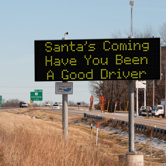 A Christmas-themed message on a MoDOT road sign east of Columbia.