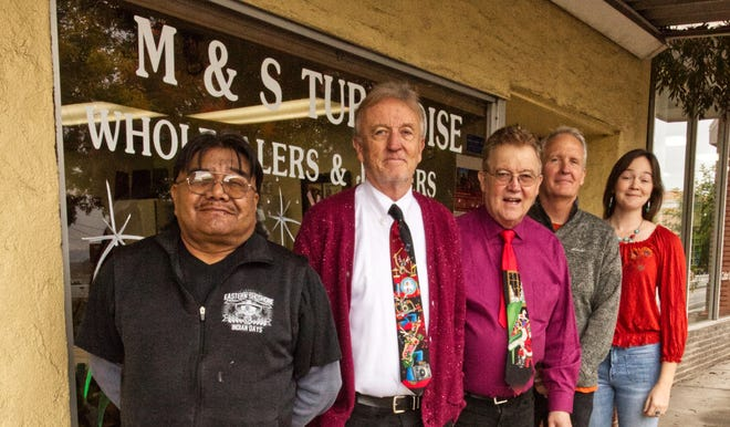 Glen Rogers, a tribal leader with the Shivwits band of southern Paiutes, left, poses with Jim Sevy, Kent Sevy and Bret Sevy, owners of M & S Turquoise, and Sarah Thomas of Conserve Southern Utah.