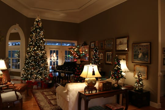 From small to tall, Starr Clay has 90 Christmas trees in her Golden Eagle home.