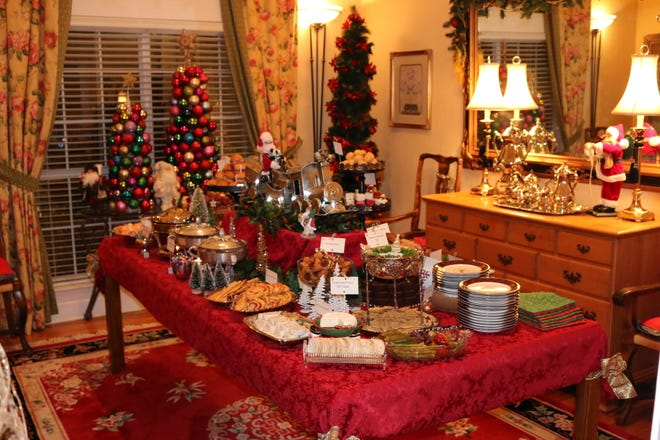 Starr Clay's dessert table is loaded with sweets and surrounded by the cheer of Christmas decor.