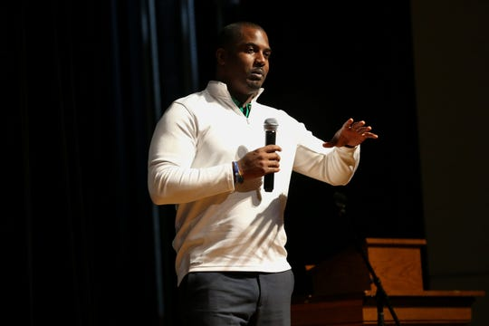 FAMU football coach Willie Simmons speaks to freshman and sophomore boys during an anti-gun violence assembly at Godby High School Tuesday, Dec. 17, 2019.