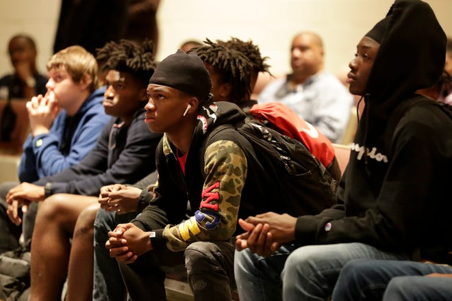 Godby freshman and sophomore male students listen as Kevin Warren, the founder of The L.I.F.E. Group, speaks to them during an anti-gun violence assembly at Godby High School Tuesday, Dec. 17, 2019.