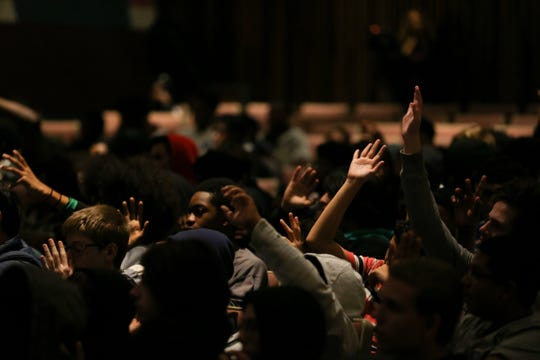 Freshman and sophomore boys raise their hands after FAMU football head coach Willie Simmons asked them who knew recently-murdered teens Amarion James and Trent Lee. He spoke to the youths during an anti-gun violence assembly at Godby High School Tuesday, Dec. 17, 2019.