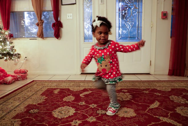 Paris Hart, 2, dances around in the living room of Making Miracles group home Monday, Dec. 9, 2019. Paris Hart's birth mother stayed at Making Miracles before she was born and was mentored by Lesa Hart, who adopted Paris.