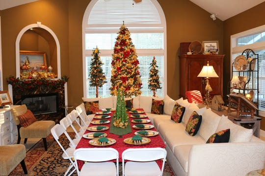 Starr Clay decorates her home with more than 90 Christmas trees