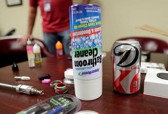 Fake canisters are used to smuggle e-cigarettes into venues. A mock bathroom cleaner canister and Diet Coke can are examples of what are being sold in vape shops.