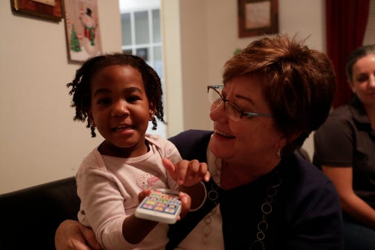 Volunteer Ginny Sapp holds J'amoria Johnson, 2, the daughter of Linda Johnson who is a resident at Making Miracles group home Monday, Dec. 9, 2019.