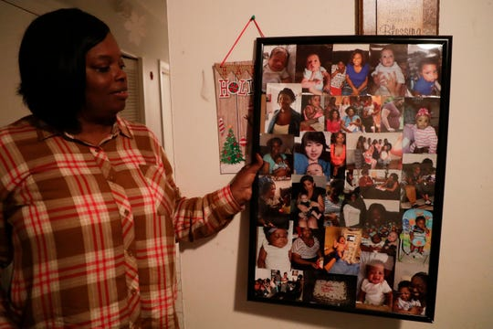 Debra Harris holds up a framed collage featuring photos of many of the women she has helped at Making Miracles group home since opening in 2010.