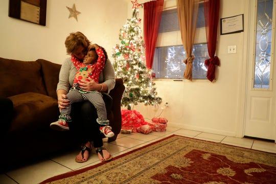 Lesa Hart hugs and kisses her adopted daughter Paris Hart, 2, at the Making Miracles group home Monday, Dec. 9, 2019. Hart adopted Paris after mentoring her birth mother at Making Miracles. `