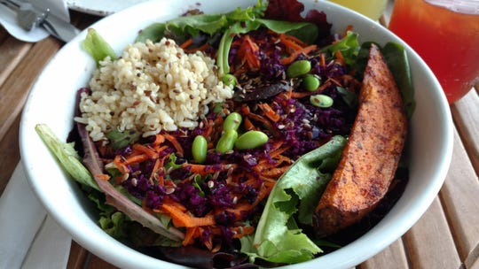 La Tabla's greens and grains salad is a large bowl of beautiful spring greens made even better by the addition of brown rice, quinoa, carrots, red cabbage, edamame and flax seeds.  The house-made balsamic vinaigrette and wedge of grilled sweet potato make it just irresistible.