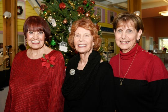 Melinda Galley, left, J.C. Stern and Linda Ryan at Poinsettia Power!, which raised nearly $85,000 for Martin County Meals on Wheels.