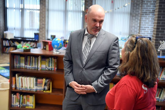 """Dr. David Moore, the new superintendent of Indian River School District, walked through Indian River Academy Tuesday, Dec. 17, 2019. Moore assured teachers Tuesday the district has""""taken every step necessary"""" to ensure they receive their performance pay bonuses for the 2018-19 school year."""