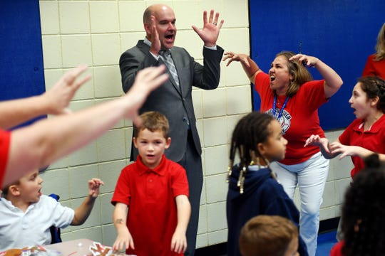 """Dr. David Moore reacts to the final roar of Indian River Academy students on Tuesday, Dec. 17, 2019, as they recite their school chant while on a tour of the campus. Moore, the new incoming superintendent for Indian River County School District, completed a two-day visit with all the traditional schools in the county before taking the job full-time on Friday, Dec. 20. """"Being able to go around visiting the school is a better way for me to understand where the district currently stands,"""" Moore said, """"and looking for opportunities to strengthen the relationship between the district and the schools. Over the last two days I've been able to meet outstanding people who are truly committed to the best interests of the children."""""""