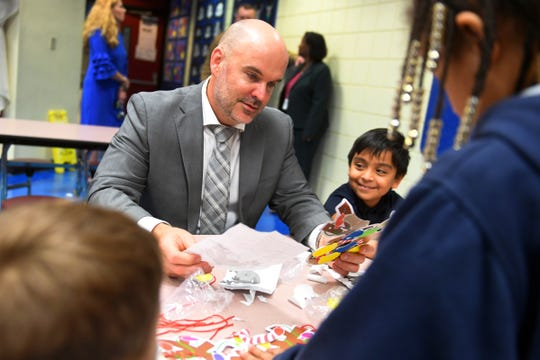"Dr. David Moore, the new superintendent of the Indian River County School District, talks with first-grader Izaiah Aguilar and his classmates on Tuesday, Dec. 17, 2019, during a tour of Indian River Academy. Moore officially takes over as head of the district on Friday, Dec. 20. ""This transition period I don't think could have been planned any better,"" Moore said. ""With the district under the leadership of Dr. (Susan) Moxley over the last few weeks, it has allowed me to do two things, exit Miami in an honorable way, a district I spent 24 years in, and to really digest all of the information I have received so that I can hit the ground running on Jan. 6 and 7."""