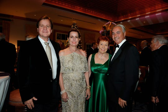 "Michael and Kimberly Thorpe, left, Helen Robertson and Dennis Hunt at the ""Cirque D' Elegance … A Night of Wonders"" on Dec. 7, 2019, a benefit for Hibiscus Children's Village."