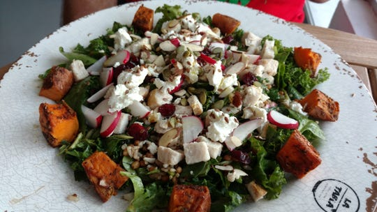 A kale-spinach salad with the addition of chunks of roasted turkey breast and sweet potato is very satisfying and enjoyable.  This La Tabla salad is a work of art with carrots, red cabbage, dried cranberries, feta cheese and crunchy seeds, dressed with an apple cider vinaigrette that pulls everything deliciously together.