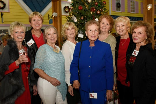 Sherrie Swygert, left, Sherry Walker, Lori Baird, Donna Gans, Inga Ernst, Barb Hammerich, Yvonne Pryhubor and Pat Tiemeyer at Poinsettia Power!, which raised nearly $85,000 for Martin County Meals on Wheels.