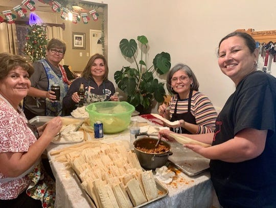 (L-r) Sisters Susana Gonzalez, Maria Chavez, Martha Aguirre, Maria Mesta and sister-in-law Judy Fernandez got together recently to make dozens of tamales for their families to enjoy. Matriarch Amada Fernandez usually gives them tips.