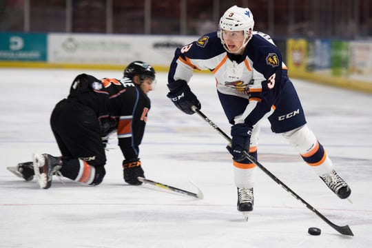 Sean Flanagan (3) of the Greenville Swamp Rabbits advances past Dan Correale (13) of the Kansas City Mavericks during their match at the Bon Secours Wellness Arena.