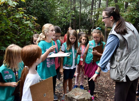 Members of Junior Girl Scout Troop 1253 talk with Richane Robbins, natural science teacher at the Roper Mountain Science Center, right. The girls raised money through Water of Life's #Crowdsourcingkids project.