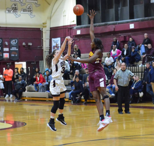 Mount Vernon forward Sanaah Hamilton steps out to contest a shot by Ossining's Lily Barossi during a season-opening loss to the Pride on Dec. 3, 2019 at Ossining High School.