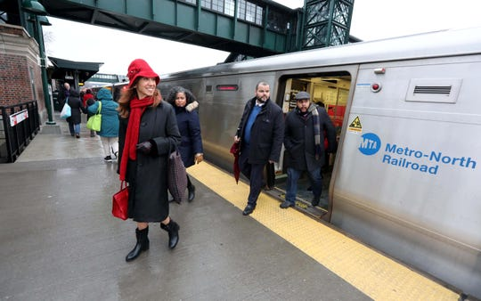 Assemblywoman Amy Paulin and other lawmakers exit a Metro-North train in Tarrytown Dec. 17, 2019 where they were joined by other lawmakers to hold a news conference demanding that the MTA spend more on improvements for Metro-North.