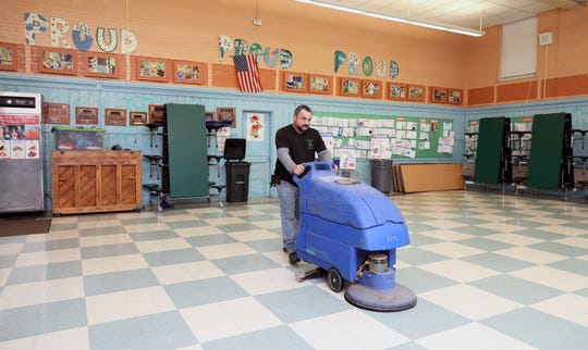 Angel Aviles, the head custodian at the Main Street School in Irvington, uses an auto scrubber to clean the cafeteria floor, Dec. 17, 2019. He was nominated by his principal, for the Cintas Corporation's Custodian of the Year Contest and chosen for the top 10 out of almost 4000 nominations.