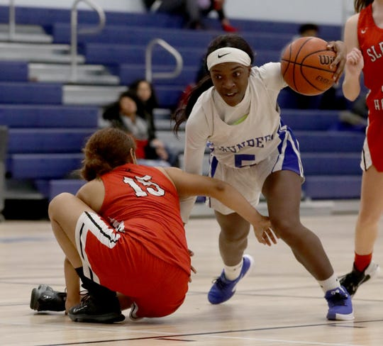 Mojisola Shokeye of Saunders gets past Jennifer Stewart of Sleepy Hollow during a varsity basketball game at Saunders High School in Yonkers Dec. 16, 2019. Sleepy Hollow defeated Saunders 49-34.