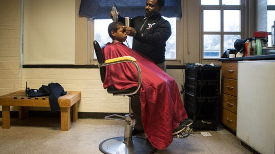 Wilmington principal uses makeshift barbershop to bond with students, one cut at a time