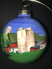 Artist MaryAnn Pahnke captured her family's 121-year-old farm on a glass ornament.