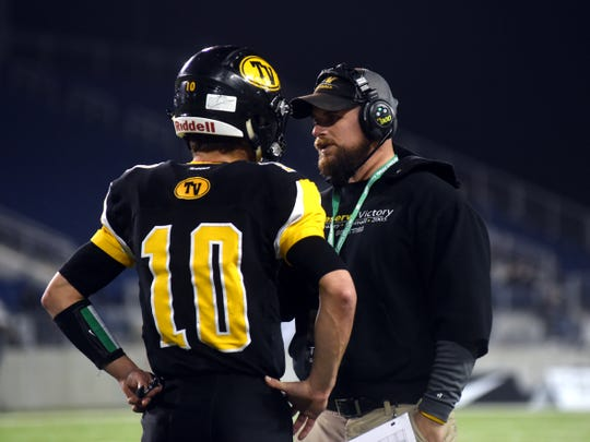 Tri-Valley's Andrew Newsom, left, talks with assistant coach Cameron West during a break in play against Trotwood-Madison in December 2017. While a student at Tri-Valley, West was All-Ohio in football and baseball and he helped lay the foundation of what the Scottie football program would became. West  went on to win a national title as a safety under coach Larry Kehres at Mount Union, then came back to coach with Justin Buttermore, where they helped take the Scotties to the Division III state finals in 2017. Now he's taking the reins as the head football coach in Dresden.